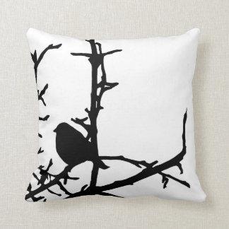 Fågel på en gren kudde