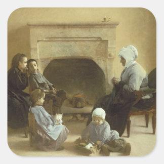 Familj som placeras runt om en härd fyrkantigt klistermärke