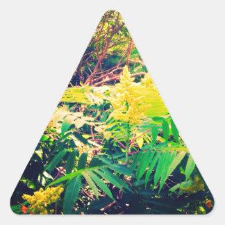 Färger av vilden triangelformat klistermärke
