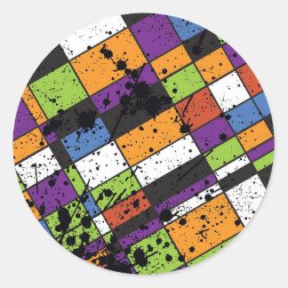 Färgglad grunge kvadrerar runt klistermärke