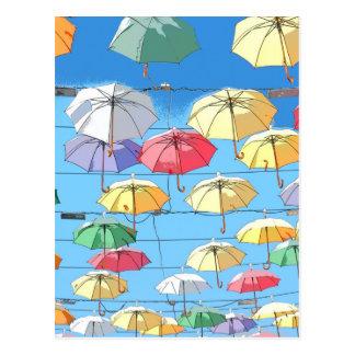 Färgglada paraplyer vykort