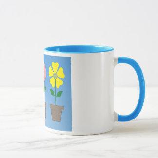 Färgrik blomkrukadesign på kaffemuggen mugg