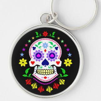 Färgrik mexicansk day of the deadsockerskalle rund silverfärgad nyckelring