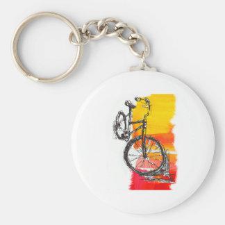 Färgrik röd cykel rund nyckelring