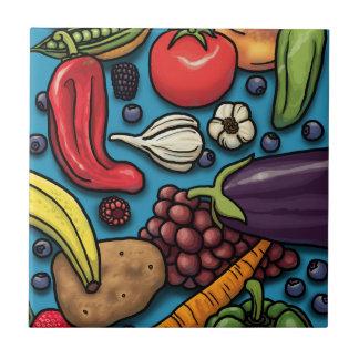 Färgrika frukter och grönsaker på blått kakelplatta