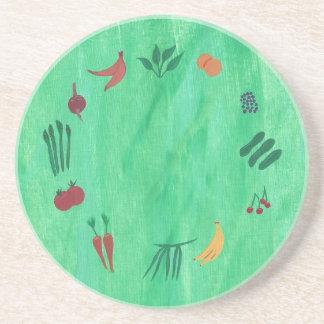 Färgrika frukter och grönsakunderlägg underlägg