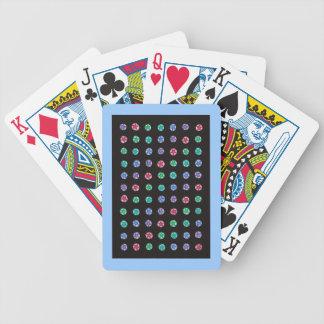Färgrika stjärnor på pastell på svarten som leker spelkort