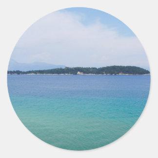 färgrikt hav runt klistermärke