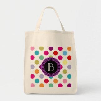 Färgrikt polka dotsmönster med monogramen mat tygkasse