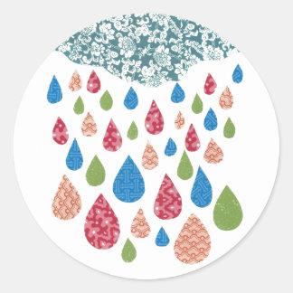 Färgrikt regna klistermärkear runt klistermärke