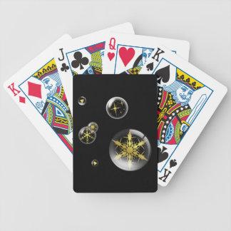 Festlig guld- julprydnad som leker kort spelkort