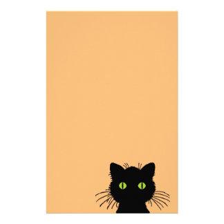 Festlig och nyfiken grönögd svart katt brevpapper