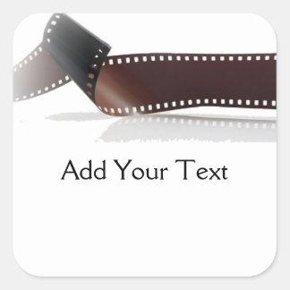 Filma remsan med reflexion på vit fyrkantigt klistermärke