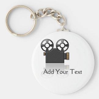 Filmkamera i svart och guld på vit rund nyckelring