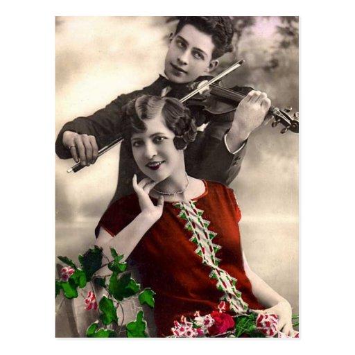 Fiolmusik som lekas av vintagemusiker vykort