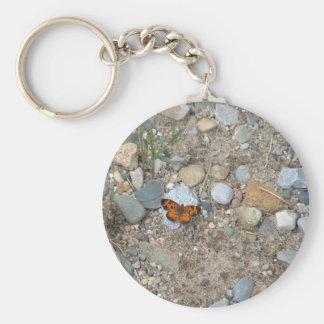 Fjäril på stenarna rund nyckelring