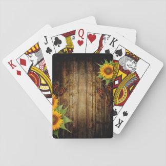 Fjärilar och solrosor som leker kort spelkort