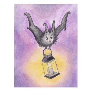 Fladdermössinnehav en lykta vykort
