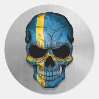 Flagga av sverigen på en grafisk stålsättaskalle klistermärke
