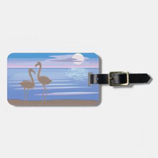 Flamingos på strandbagagemärkren bagagebricka