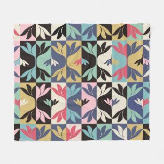 Fleecefilt med grafiskt mönster