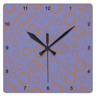 flickaktigt orange lilor cirklar kvadrerar det yr fyrkantig klocka