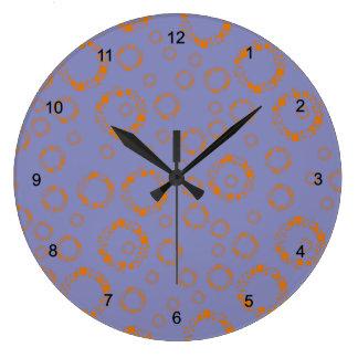 flickaktigt orange lilor cirklar kvadrerar det yr stor rund klocka