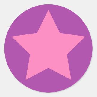 Flickaktigt rosa och purpurfärgad stjärna runt klistermärke
