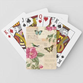 Flickaktigt vintage som leker kort med rosa & kortlek