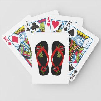Flinflip flops som leker kort spelkort