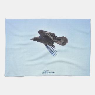 Flyga som är korpsvart i fotodesign för blå himmel kökshandduk