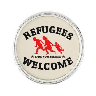 Flyktingvälkomnandet kommer med dina familjer som rockslagsnål