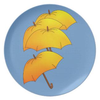 Flyta det gula paraplyet tallrik