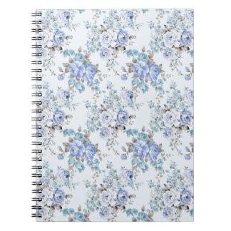 För blommamönster för blått rosig anteckningsbok