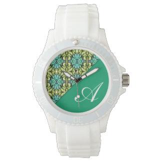 För grönt klocka flickaktigt med initialt