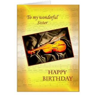 För syster ett musikaliskt födelsedagkort med en hälsningskort