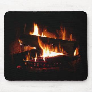 För vinterplats för spis varm fotografi musmatta