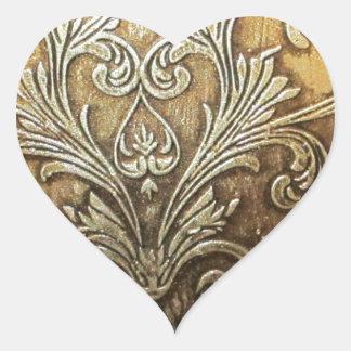 Forntida förgylla hjärtformat klistermärke