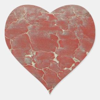 Forntida måla hjärtformat klistermärke