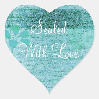 Förseglat med kärlekklistermärkeblått & hjärtformat klistermärke