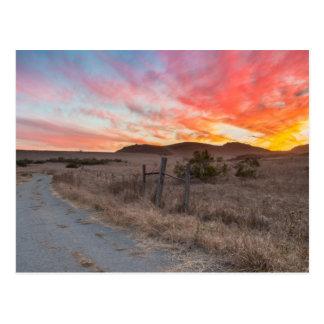 Första solnedgång av dagen vykort