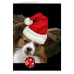 Förtjusande Papillon hund i en Santa hatt Hälsningskort