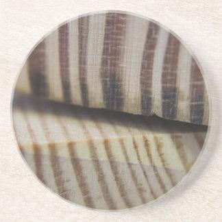 Fotografera av trä underlägg sandsten