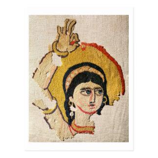Fragment av en tapestry som visar huvudet av en vykort