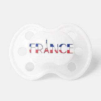 Frankriken sjunker med Eiffel tornblått som är Nappar För Bebisar