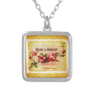 Fransk parfymetikett för vintage silverpläterat halsband
