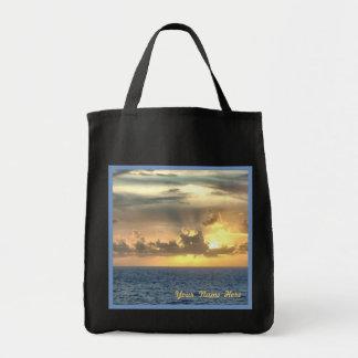 Fridfull soluppgång över hav mat tygkasse