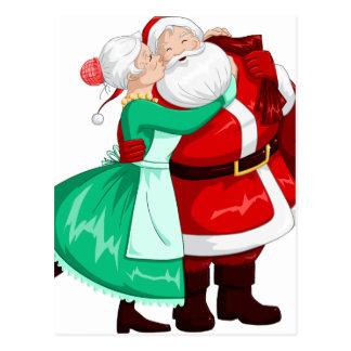 Fru Claus kysser Santa på kind och kramar Vykort