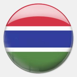 Gambia flagga i exponeringsglas (packen) runt klistermärke