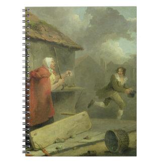 Gammal kvinna som vinkar en pinne på en pojke 179 spiralbundna anteckningsböcker